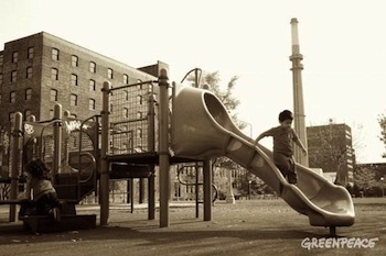 Child playing at Dovak Park with Fisk Coal Plant in the background [via Greenpeace]