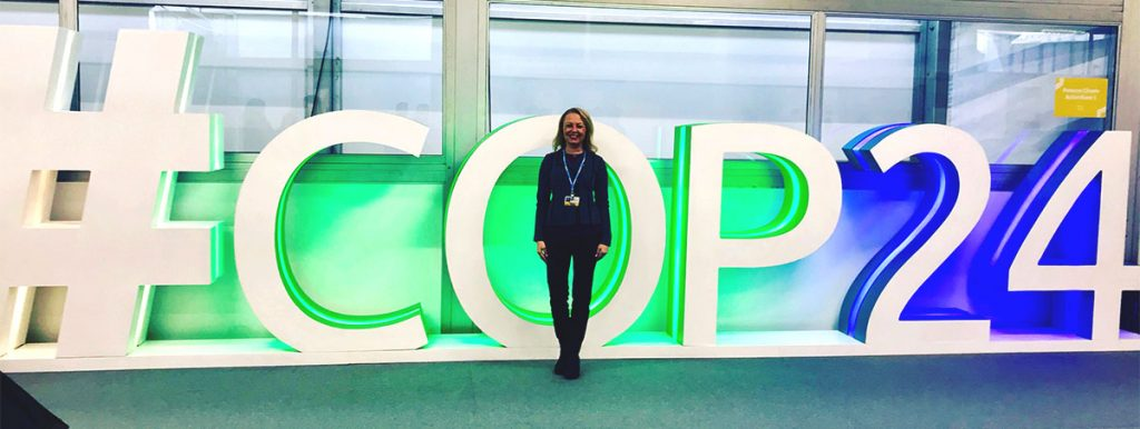 Alissa Matthies Tamasi in front of COP24 sign