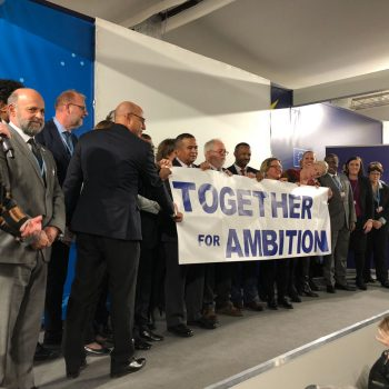 Global leaders hold Together for Ambition sign