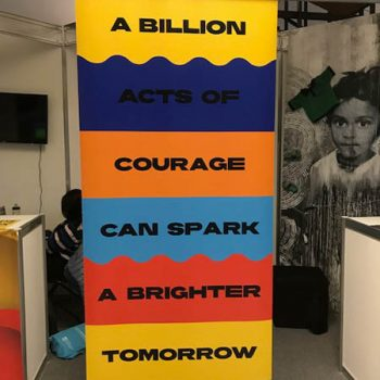 banner from Green Pace that says `a billion acts of courage can spark a better tomorrow`