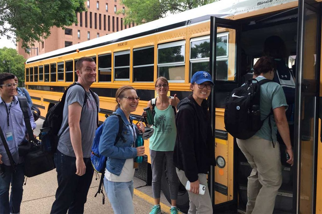Teachers attending the Summer Institute for Climate Change Education board a bus