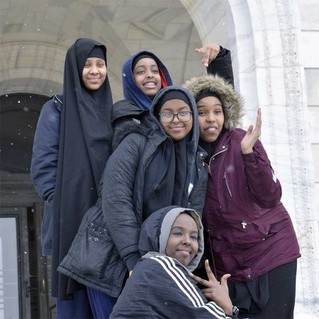 Youth pose on the capitol steps.
