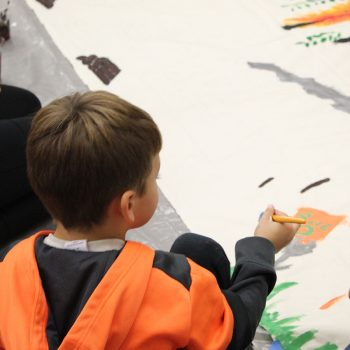 Drawing and painting a mural.