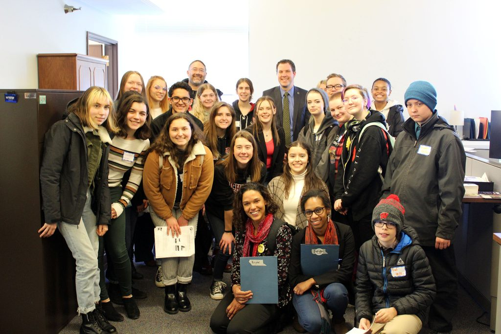 Students pose with Rep. Jamie Long after their meeting together.
